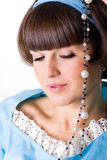 Brunet woman with pearl beads Royalty Free Stock Photo