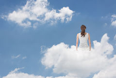Brunet woman sit on clouds. And look far away, concept of lifestyle, relaxation, free and holiday etc Stock Image