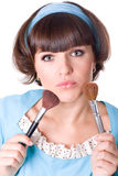 Brunet woman with two make-up brushes Royalty Free Stock Photography