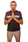 Brunetka mężczyzna modli się chrystianizm ręki wpólnie Zdjęcie Stock