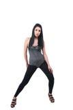 Brunetki damy odzieży czerni leggings, leotard i klinów sandały, fotografia royalty free