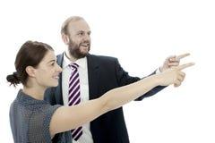 Brunetki młoda kobieta i biznesowy mężczyzna wskazujemy z lewej strony zdjęcia stock