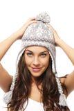 brunetki nakrętki chwyta cukierki target1596_0_ zima kobiety potomstwa obraz royalty free