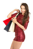 Brunett woman with shopping bags Royalty Free Stock Photography