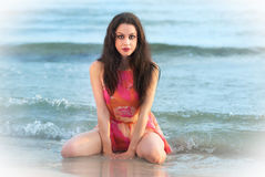 Brunette adorable girl on summer beach. Young brunette woman on the summer beach Stock Image
