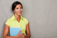 Brunette adult female carrying mobile technology Royalty Free Stock Photo