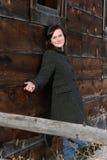 Brunette against barn Royalty Free Stock Photo
