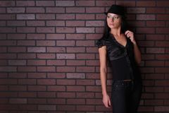 Brunette Against The Wall In A Shirt And A Hat Royalty Free Stock Photo