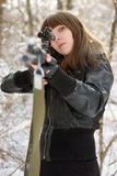 Brunette aiming a gun Stock Photos