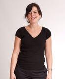 Brunette alegre no preto Fotografia de Stock