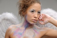 Brunette in angel costume Royalty Free Stock Photo