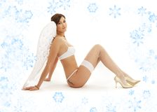 Brunette angel girl in white lingerie with Royalty Free Stock Photo