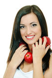 Brunette with apple Royalty Free Stock Photography