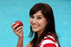 Brunette and Apple Royalty Free Stock Images