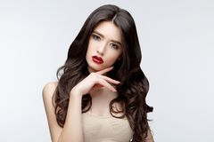 Brunette asian girl with long curly hair Stock Photography