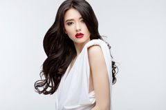 Brunette asian girl with long curly hair Royalty Free Stock Images