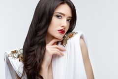 Brunette asian girl with long curly hair Royalty Free Stock Image