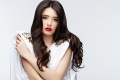 Brunette asian girl with long curly hair Stock Photos