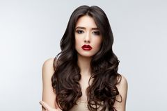 Brunette asian girl with long curly hair Stock Photo