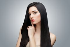 Brunette asian girl with long straight hair. Studio shot stock images