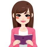Brunette Asian Girl Reading. Beautiful brunette Asian girl reading interesting book Royalty Free Stock Image