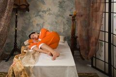 Brunette asleep in a luxury bedroom Stock Photo