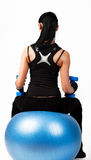 Brunette athlete holding weights Stock Photography