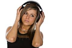Brunette atractivo con los auriculares Fotografía de archivo