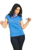 Brunette atractivo en camiseta azul en blanco Imagen de archivo libre de regalías