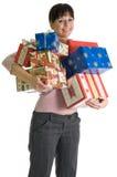 Brunette atrativo com armful de presentes do X-mas Imagem de Stock