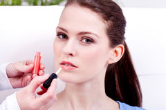 Woman applying lipstick on lips natural beauty Royalty Free Stock Image