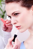 Woman applying lipstick on lips natural beauty Stock Image