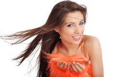 Brunette attraente in costume arancione Fotografie Stock