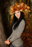Brunette in the autumn forest with a crown Stock Images