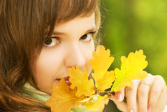 Brunette with autumn leaf Royalty Free Stock Photography