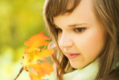 Brunette with autumn leaves Royalty Free Stock Photography