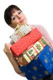 Brunette avec des cadeaux de Noël Photo stock
