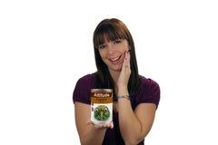 Brunette avec un bidon d'assiette, saveur excentrique Image stock