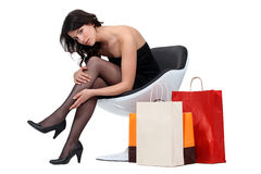 Brunette back from shopping Royalty Free Stock Images