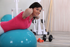 Brunette balanced on ball Royalty Free Stock Images