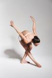 Brunette ballerina bending down to leg Stock Photos