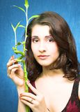 Brunette with bamboo Stock Photo