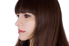 Brunette bangs hair style. Bangs hair style on a beautiful brunette in her early 30's royalty free stock photo