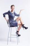 Brunette on bar stool Royalty Free Stock Photos