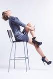 Brunette on bar stool Stock Photos