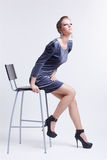 Brunette on bar stool Royalty Free Stock Photography