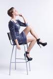 Brunette on bar stool Royalty Free Stock Photography