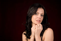 Brunette with bare shoulders Stock Images