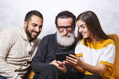 Senior Man Sitting With His Children stock image