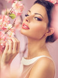 Brunette beautie with the flowers stock photos